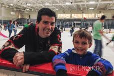 Mr. Joe showing Patrick the hockey moves.