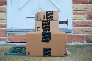 IMAGE OF AMAZON PACKAGES PHOTO VIA Julie Clopper / Shutterstock.com