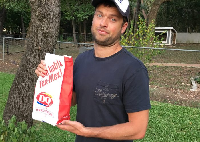 Mr. SkinnyPants hold a Dairy Queen bag.