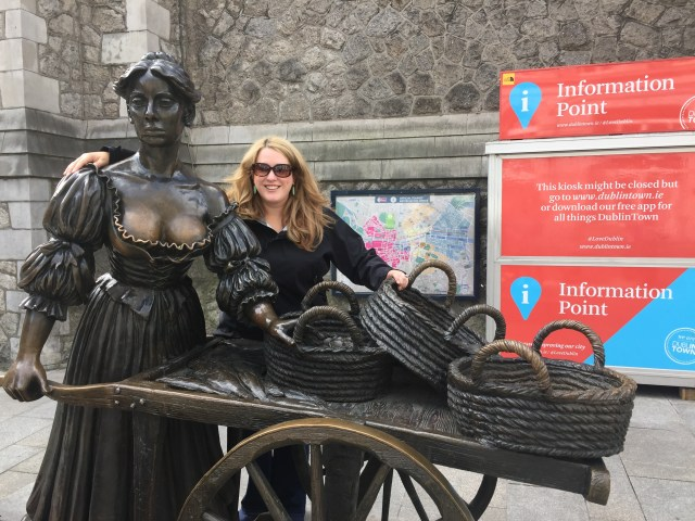 The buxom Molly Malone status and her baskets of oysters in Dublin, Ireland.