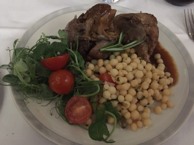 The braised lamb shank dinner course on Singapore Airlines MAN to IAH.