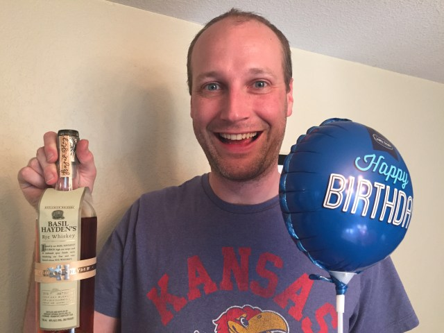 A very happy birthday boy celebrates his 35th birthday with gifts delivered all day via on-demand apps for my husband's 35th birthday.