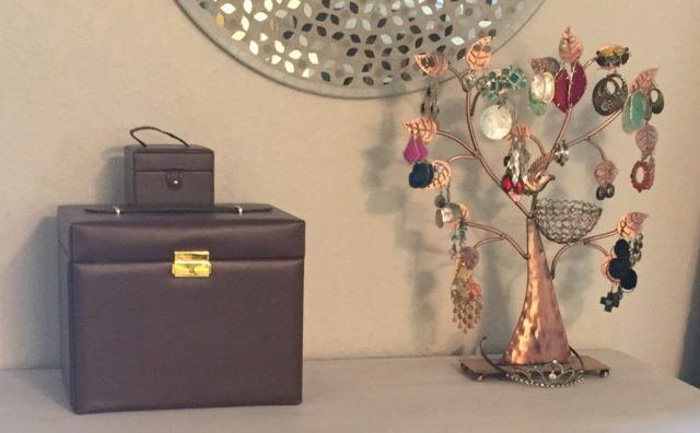 "A traditional jewelry organizer combined with a visually stunning earring ""tree"" make a workable solution to corralling all my jewelry into one spot."