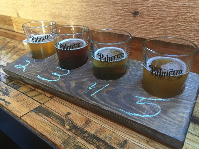 "The ""build your own"" tasting flight at the Palmetto Brewery in Charleston, South Carolina — just chalk in the numbers of the beers you want to try out of about 12 on offer."