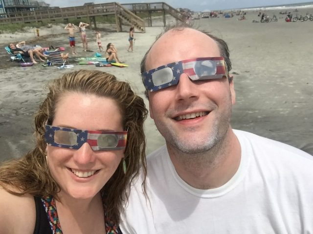 Looking goofy in our eclipse glasses at Folly Beach. Ignore the hubby's sunscreen-y beard, haha.