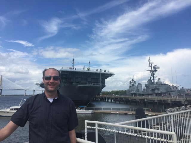 The hubby with the impressive warships at Patriot's Point.