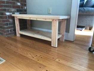 raw wood entryway bench is not level