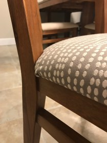 closeup showing fabric is tightly stretched on upholstered chair seat