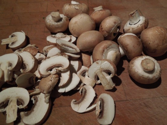 Image of mushrooms, whole and sliced