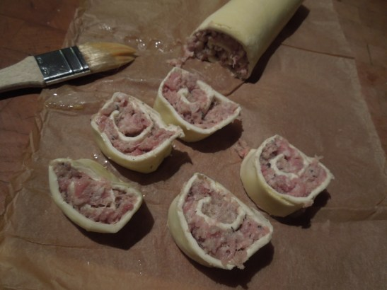 Image of sausage pinwheels being sliced