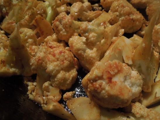 Image of cauliflower coated with smoked paprika and lemon