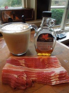 Image of pancake batter, maple syrup and bacon