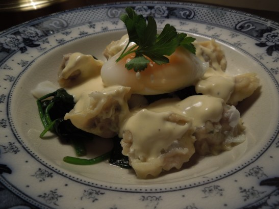 Image of confit duck ravioli with duck egg and parmesan cream