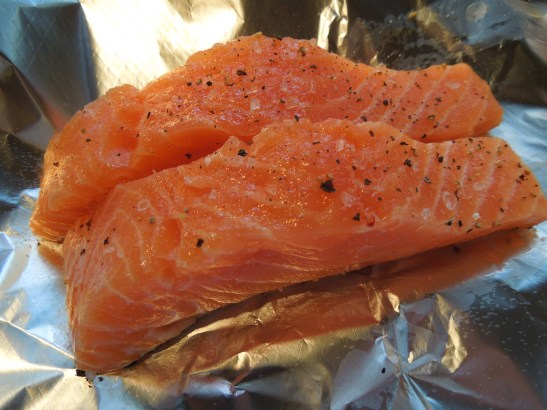 Image of salmon being wrapped in foil for baking