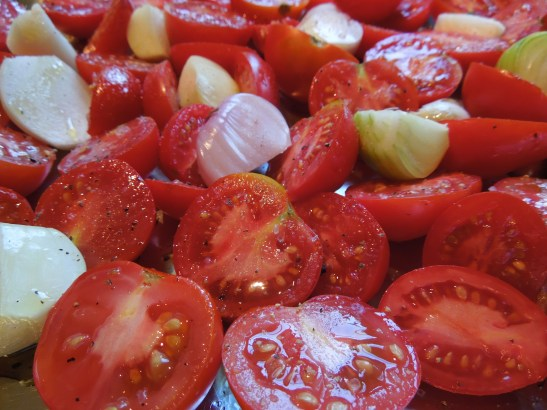Image of tomatoes, shallots and garlic ready for the oven