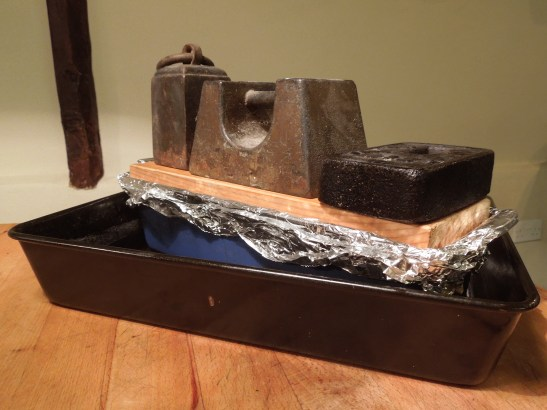 Image of cooked terrine weighted down