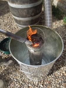 Image of sawdust being lit inside mesh column