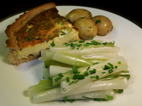 Leeks vinaigrette served with quiche and new potatoes