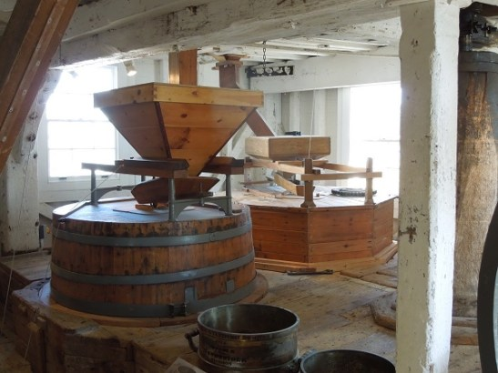 Image of grain hopper and milldstones at Woodbridge Tide Mill
