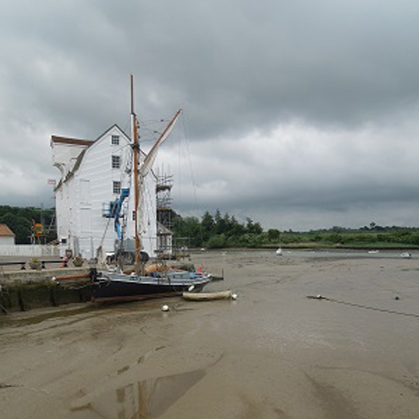 Image of mill at low tide