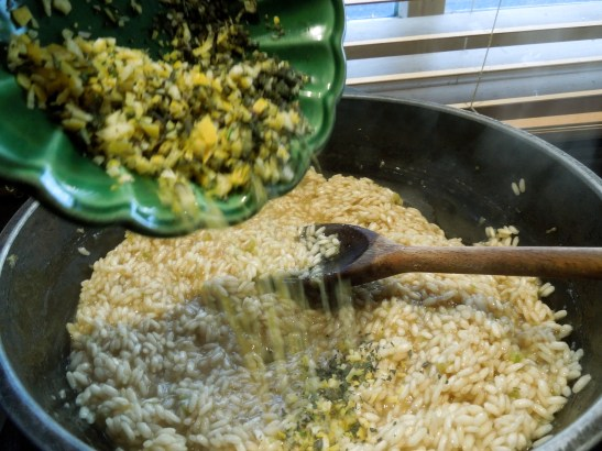 Image of lemon peel and herbs being added to the risotto