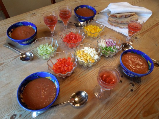 Image of table set with gazpacho and trimmings