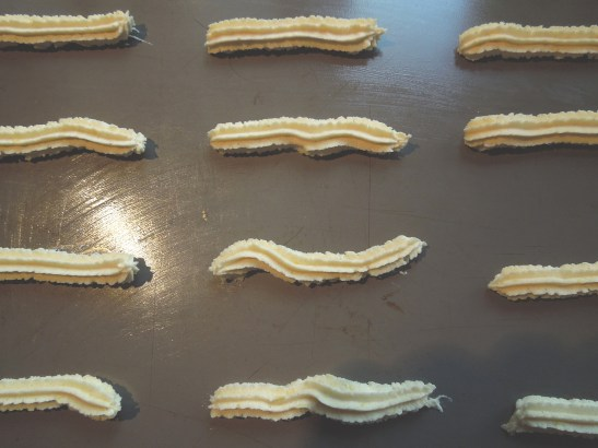 Image of biscuit mix piped onto baking sheet