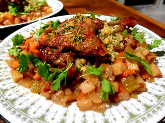 Braised duck legs with orange gremolata, served