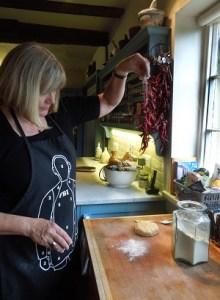 Image of Mrs Portly sprinkling flour.