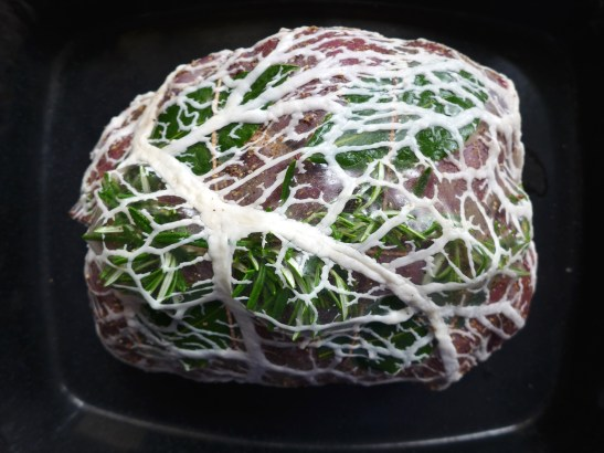 Image of venison haunch wrapped in caul fat