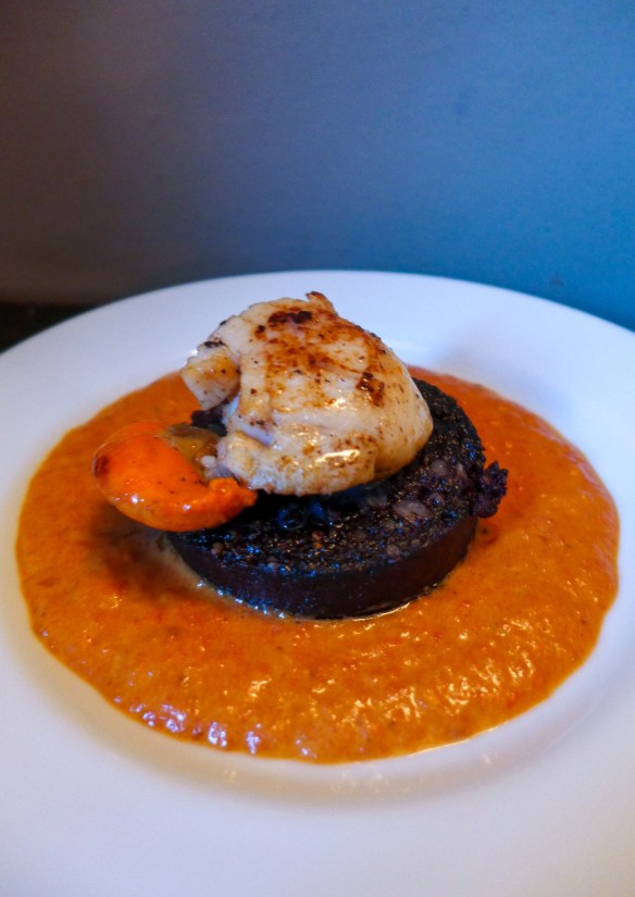 Scallops with black pudding and a tomato and pernod sauce