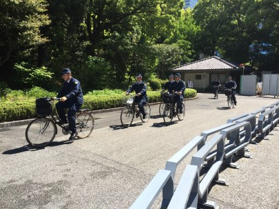 Police shortcut through the Imperial Palace.