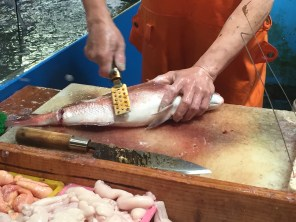 Workman's hands at the fish market.