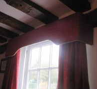 Pelmet with taped heading on curtains