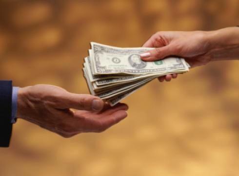 hands exchanging money  MrTopStepcom