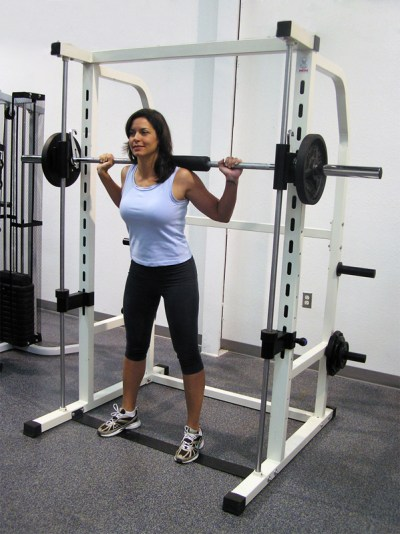 Woman on a smith machine about to do squats