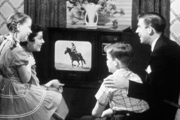 Family Gathered around a TV in fifties/sixties