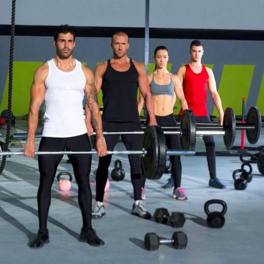 Crossfit group doing deadlifts looking at you