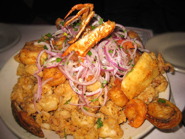 salad made of fried calamari, shrimp, fish, mussels, crab and raw onions