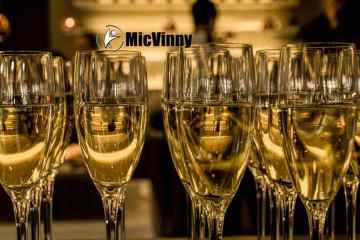 New Year's Eve glasses of champagne celebrating resolution weight loss from Mr. Travel Fitness