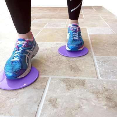 person using pair of gliding discs under their feet
