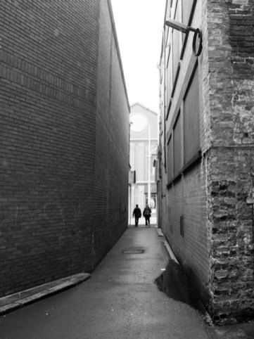 Leaving a dark alley.
