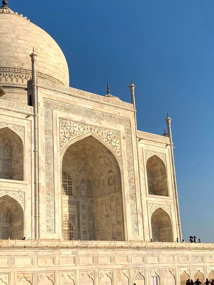 The magnanimous carvings on Taj Mahal, also seen in perspective with the size of visitors.
