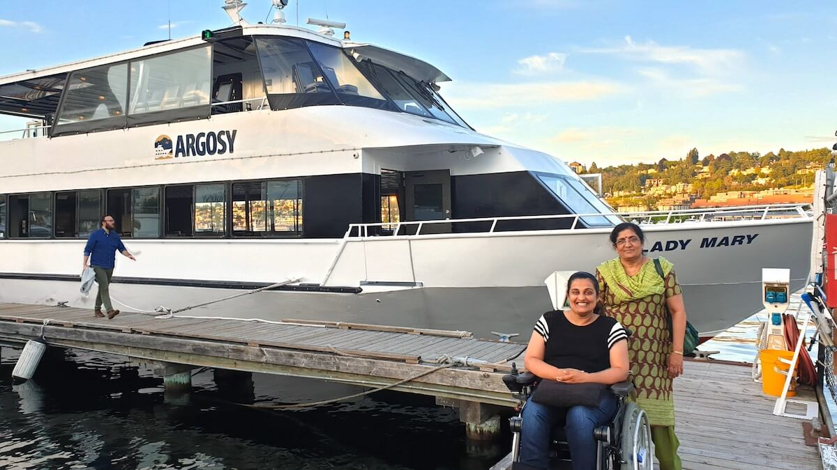 With my mother at the marina, ready to board Argosy cruise boat at Lake Washington. Behind me is the ramp that we used to go inside the boat with my wheelchair.