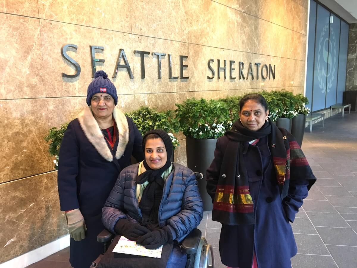 Standing outside Sheraton Grand Seattle hotel with my mother and helper. This photograph is from February, the weather was very cold for us :-)