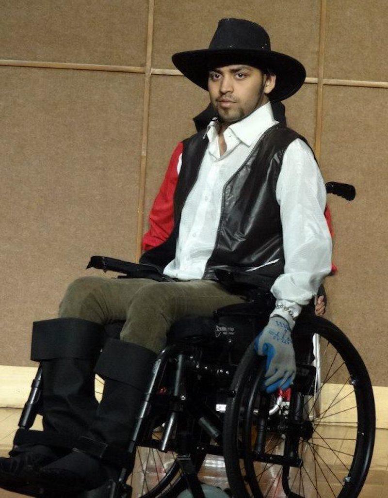 Tarang dressed as a cowboy for a fashion show