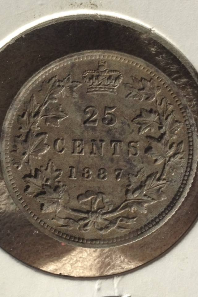 A Canadian quarter from 1887.