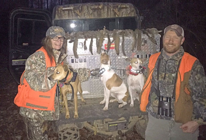 Kris Goodwin (left), of Starkville, and James Austin display a fine harvest of squirrels and the well trained dogs that made the harvest fun.