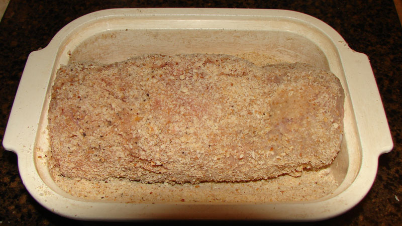 Flattened twice, the turkey is ready to be layered with prosciutto and cheeses.