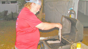 The author puts king mackerel fillets on a grill that's been preheated to medium.